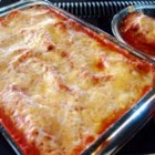 Three Meat Cannelloni Bake - An savory mix of veal, pork and beef, cooked with onion, celery, carrots, garlic, wine and herbs, is  enriched with an opulent Parmesan cheese sauce. Roll the mix with strips of fresh pasta to make stuffed tubes, then bake with a creamy tomato sauce.