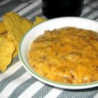 Dog Food Dip - This dip recipe was given to me by a co-worker some 15 or more years ago. She made it for potlucks at work, and it was always gone from the nurse's station before the rest of the food was put out! It's a simple mixture of beef and cheese, but it should always be made a day in advance to allow the flavors to blend. Serve with your favorite corn chips.