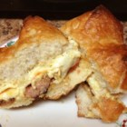 Hot Smoked Sausage and Cheese Sandwich - Beef smoked sausage slices and Muenster cheese are sandwiched between split sweet Portuguese rolls spread with a creamy, spicy mustard sauce and baked until warm and cheese is melted.