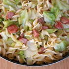 Polska Kielbasa with Cabbage and Egg Noodles - Browned kielbasa and onions are simmered with chopped cabbage then mixed with egg noodles for a quick and easy hearty weeknight dinner.