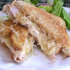 Grilled Turkey Reuben Sandwiches - Heating the sauerkraut and turkey before assembling the sandwiches ensures that the filling is warmed through in this indulgent meal.