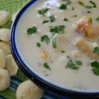 New England-Style Clam Chowder - This recipe delivers a bowl full of clams, ham, and potatoes in a creamy soup for the kind of soul food experience you otherwise would have to travel to New England to experience.