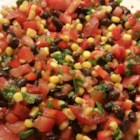 Zesty Black Bean and Corn Salsa - This simple recipes for a black bean, corn, and tomato salsa is finished with zesty Italian salad dressing.