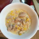 Cheesy Slow Cooker White Chili - This white chili recipe calls for a mixture of great Northern beans, cooked chicken breast, corn, and cheese to be slow cooked in a mixture of Alfredo sauce and chicken broth.