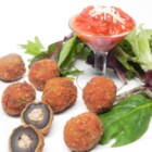 C and L's Stuffed Black Olives - Black olives are stuffed with a seasoned beef and pork mixture, breaded and deep fried.