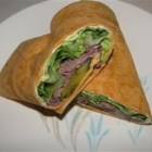 Roast Beef and Avocado Wraps - Tomato-herb tortillas layered with a cumin-garlic cream cheese spread, deli roast beef, lettuce, cubed avocado and tomatoes, and grated Colby-Jack cheese makes a totally satisfying wrap.