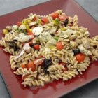 Quick Artichoke Pasta Salad - This pasta salad is quick and easy to make. The liquid from the marinated artichoke hearts makes an excellent dressing.
