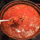 North End Sunday Gravy - This is a long-simmering homemade Italian 'gravy' with meatballs, featuring a savory herbal taste thanks to the addition of basil, mint, and red pepper flakes.