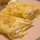 Herbed Cream Cheese Omelet -  Omelet phobia? Not with this recipe. Follow the directions and you 'll create not only perfect omelets, but omelets that your guests will swoon over. Eggs, cilantro, butter and cream cheese ...and a bit of technique.