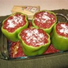 Stuffed Peppers with Creole Sauce - The freshly-made Creole sauce puts a different twist on stuffed peppers, and really makes this dish!