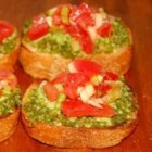 Bruschetta II - A little French ...a little Italian ...and the end result is a sensational appetizer. A scrumptious spinach/basil pesto is whirled in the food processor until of spreading consistency. Slices of baguette are lightly toasted and then anointed with the pesto.