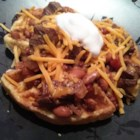 Trina's Beef Brisket Chili with Cornbread Waffles - A richly flavored, smoky chili full of cooked beef brisket and beans is served over hot cornbread waffles for a filling and tasty meal great for a cold day.