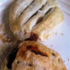 Eccles Cakes - A sweet currant and mixed peel filling is baked in puff pastry in these traditional English pastries.
