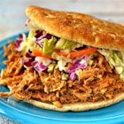 Pulled Pork Ya'll - Pulled pork in a perfectly seasoned sauce is made in the slow cooker for an easy meal for potlucks or weeknight dinner.