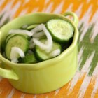 Buryl's Ice Box Pickles - Sweetened apple cider vinegar is tossed with cucumber and onion in this 'ice box pickle' recipe.