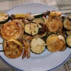 Easy Cajun Grilled Veggies - A light mixture of Cajun seasoning and Worcestershire sauce gives zucchini, squash and onion chunks a delicious, flavorful bite.