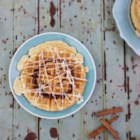 Cinnamon Roll Waffles - Get all of the goodness of a cinnamon roll in your breakfast waffles with this recipe that the whole family will enjoy.
