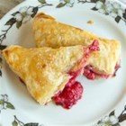 Fresh Raspberry Turnovers - This flaky pastry filled with fresh raspberry is truly a delight. Serve warm with ice cream for an added treat.