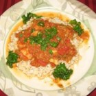 Shrimp Creole IV - Shrimp Creole made with fresh shrimp stock, onions, green peppers, tomatoes, herbs, and shrimp. Great over rice and served with French bread for dipping.