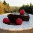 "Chef John's Chocolate Decadence - Chef John's recipe for chocolate decadence, a ""flourless"" chocolate cake, produces a rich and delicious cake your valentine will love."