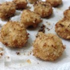 Easy Chicken Balls - A mixture of ground chicken, three cheeses, cloves, onion, eggs and seasoning makes for great golden fried chicken balls!