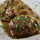 Midwest Salisbury Steak - This Salisbury steak recipe uses ground sirloin to get a leaner, meatier-tasting main dish with enough mushroom and onion gravy to top your sides, too.