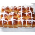 Hot Cross Buns I - An Easter tradition, these lightly sweetened cinnamon yeast buns feature tender little currants strewn throughout.  An egg yolk wash gives these buns a browned, glossy finish, making a canvas for the namesake cross, a painting of milk and sugar icing.