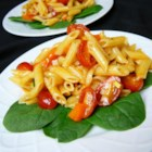 Marinated Macaroni Salad - This salad is marinated in a dressing with ketchup, sugar, and vinegar for flavors even the kids will love.