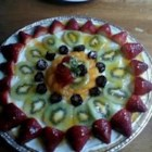 PHILADELPHIA(R) Fruit Pizza - On a baked cookie 'crust,' arrange sliced kiwi, berries and mandarin orange segments on a creamy layer of 'sauce' for a pretty summer dessert.