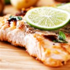 Clamato(R) Cooked Salmon - Fast food doesn't have to be boring! Catch a Pacific breeze and delight your taste buds with this salmon dish seasoned with the distinctive flavors of Clamato(R), garlic cloves, jalapeño, basil and more.