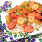 Andouille, Shrimp, and Chicken Jambalaya - Get ready for a Mardi Gras dinner for the whole family using this recipe to get a big pot of the classic sausage, shrimp, chicken, and rice dish.