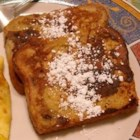 Ultimate French Toast - This is a good, old-fashioned way of making delicious French toast. To add a little pizzazz to it, sprinkle on some cinnamon after dipping the bread into the batter. Serve hot with butter and maple syrup.