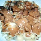 Slow Cooker London Broil - The steak is cooked with condensed tomato soup mixed with cream of mushroom soup. Dry onion soup mix is sprinkled over the top.