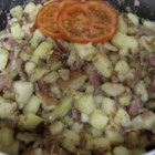 Corned Beef Hash (Abalos style) - Corned beef, potatoes, tomatoes, onions, and tons of garlic make this Filipino family recipe an excellent quick and easy dish to serve over rice.