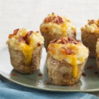 Roasted Garlic Twice-Baked Potatoes - Fresh roasted garlic swirled into baked potato with Velveeta and Parmesan, then baked again. Scrumptious. You'll be thanked every time these cheesy delights appear at dinner.