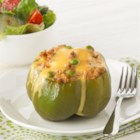 Slow-Cooker Stuffed Peppers - This slow-cooker recipe takes just 15 minutes of prep in the morning-so you can come home to a cheesy and tender stuffed pepper dish in the evening.