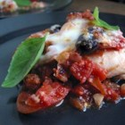 Eggplant Parmigiana Caponata - Sauteed eggplant, red bell peppers, and onion are topped with a tangy tomato sauce, melted mozzarella, and Parmesan cheeses. Capers and (optional) anchovies add savory flavors to this cross between eggplant Parmesan and caponata. Serve with linguini or your favorite pasta.