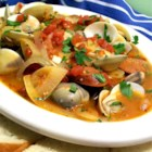 Portuguese Steamed Clams - Being of Portuguese decent and raised in Rhode Island along the Eastern   seaboard, this recipe is a wonderful combination of my two heritages. If desired serve with a small cup of melted butter for dipping clams and don't forget a fresh loaf of warm, crusty bread!!! Note: If the clams seem sandy, soak them for a couple of hours or overnight in the refrigerator in salted water with a bit of vinegar, cornmeal, and cayenne pepper.