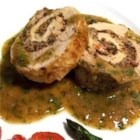 Pan Roasted Pork Tenderloin with a Blue Cheese and Olive Stuffing - Pork tenderloins are pounded flat, spread with olive tapenade, and blue cheese, then rolled up and roasted. A Dijon-lemon sauce finishes this elegant dish. Your guests will surely be impressed!