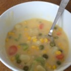 Cheesy Vegetable Chowder  - Potatoes, celery, carrots, corn, peas and green beans make appearances in this cheesy chowder.