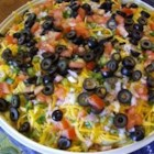 Mexican Layered Dip - Like seven-layer salad, but with zesty Mexican ingredients that you can easily tuck into with chips.
