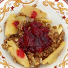 Apple Crisp with Cranberry Compote - An apple crisp with an oat crumble topping is served with warm cranberry compote in this easy recipe for fall.