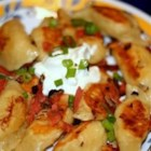 Grandma's Polish Perogies - My grandfather is Polish, and his mother taught my grandmother how to make these delicious perogies. Serve plain, or with butter, sour cream, bacon, etc.