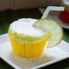 Margarita Cupcakes - All the fixings for a margarita, tequila, margarita mix, and lemon-lime soda, are mixed with cake batter in this tasty recipe for margarita cupcakes.