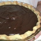 Double Chocolate Pie - There 's chocolate chips, squares of unsweetened chocolate, and lots of eggs and milk in this creamy, rich pie. The filling is cooked up until thick and lovely and poured into a baked pie shell. It can be made two days in advance.