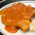 Pork Chops in Red Sauce - Tender pork chops baked in an easy to make tomato sauce.