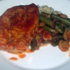 Pork Chops Capri - My grandma's recipe - pork chops simmered in a spicy tomato sauce with green beans and mushrooms. Wonderfully delicious, uses only one pan, and is easy to make. Enjoy!