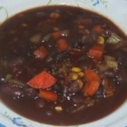 Heddy's Black and Red Bean Soup - A yummy soup that even picky kids will love! Red beans and black beans are mildly seasoned and simmered in vegetable broth. With these ingredients this is a healthy vegetarian soup with a complete protein. If you add the chili powder, leave out the maple syrup. It totally changes the taste. Garnish with sour cream, green onions and tortilla chips for a festive meal. This is great served with cornbread.