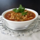Chicken and White Bean Chili - This white bean chili recipe features chicken and cannellini beans in chicken broth, with jalapeno peppers, salsa, cumin, and chili powder bringing the flavor.