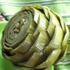 Artichokes - Simple and delicious steamed artichokes. Serve these with melted butter for dipping. You will need a pan with a steamer insert.
